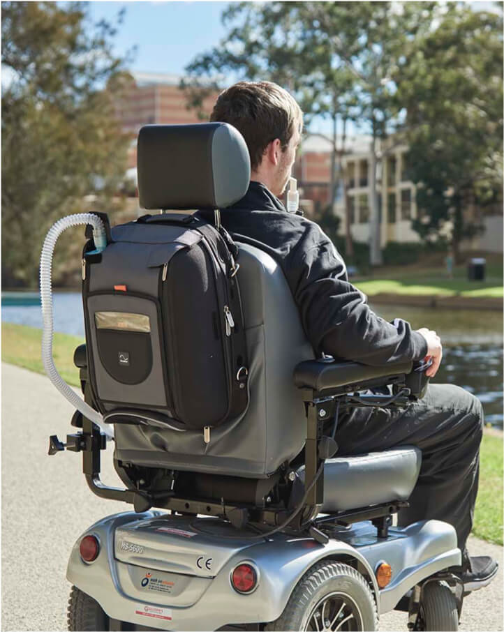 ventilation-traveling-with-a-ventilator-man-in-motorized-wheelchair-using-ventilation